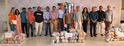 Solenidade de entrega alimentos arrecadados no festival Ribeira Boêmia, para entidades beneficiadas pelo programa Mesa Brasil do Sesc RN